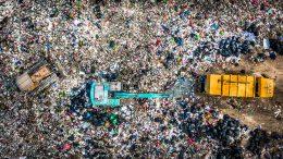garbage pile trash dump landfill aerial view garbage trucks unload garbage landfill global warming 1